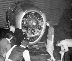 Old black and white photo of students and a propeller