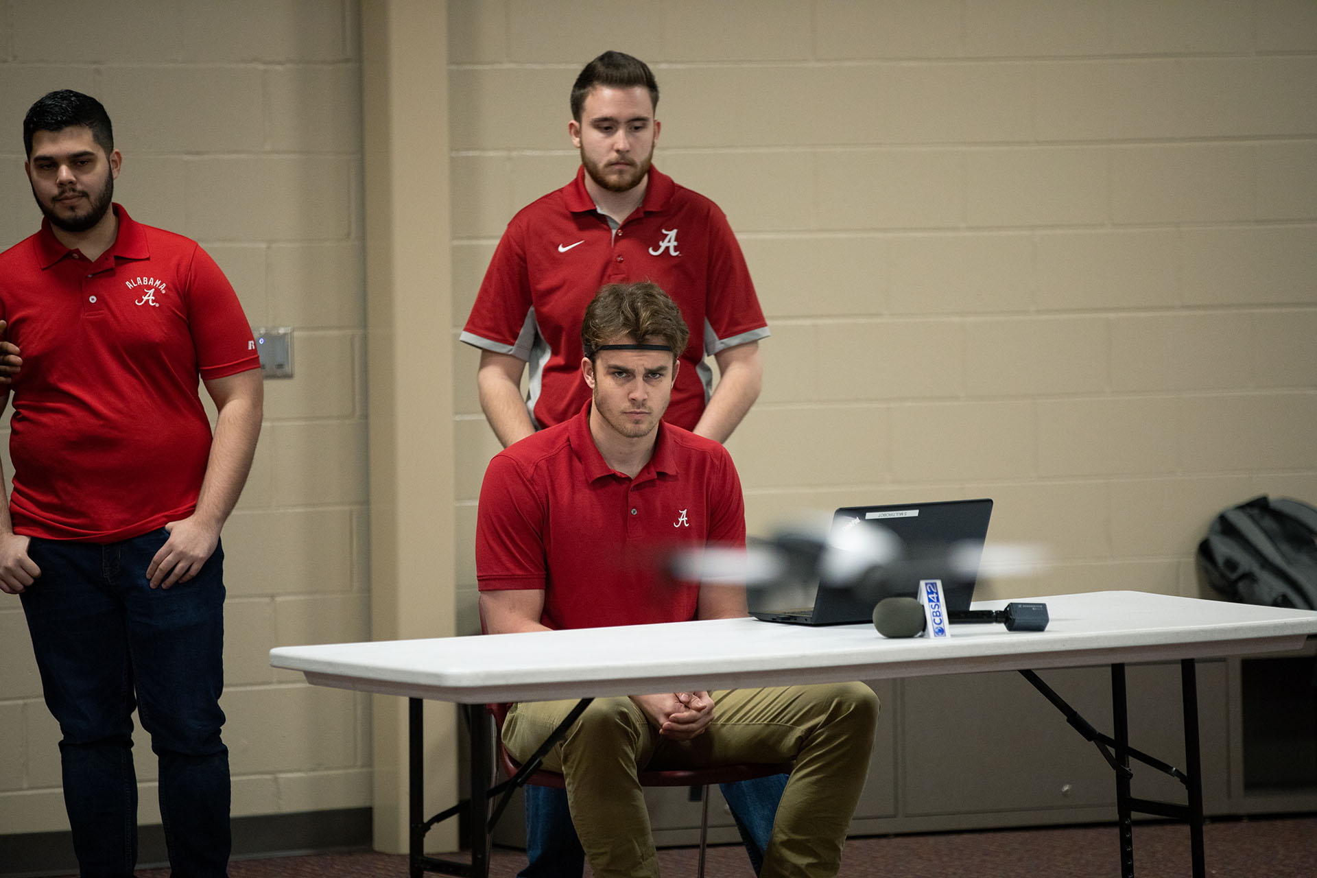 Computer science students fly a drone
