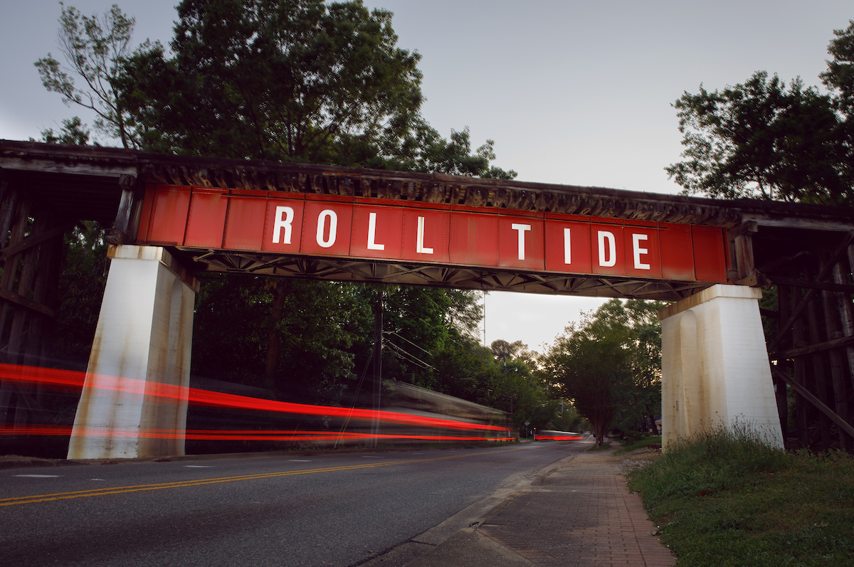 Roll Tide painted on the side of a bridge