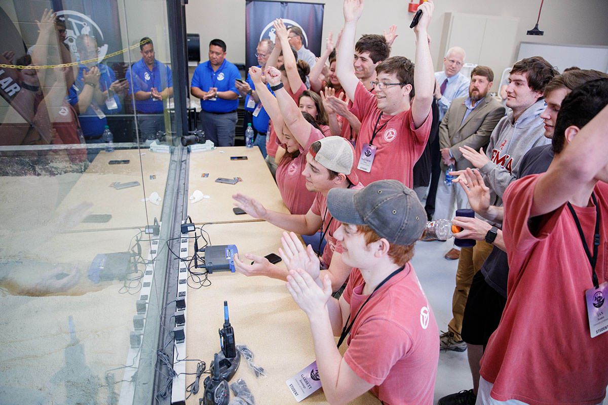 Students cheering at the nasa robot's success