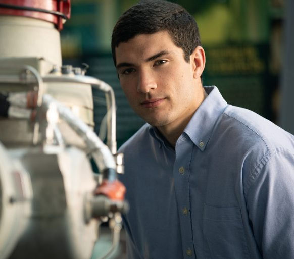 LinkedIn photo of Peyton Strickland looking at complex machinery.