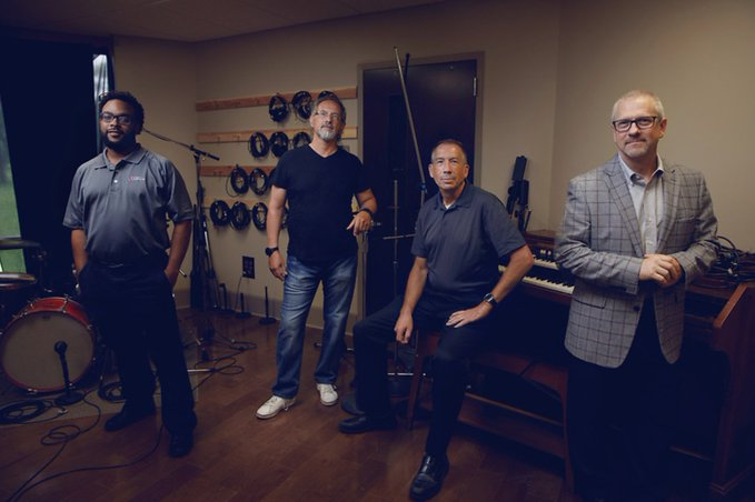 Facebook photo of four guys in a audio engineering room.