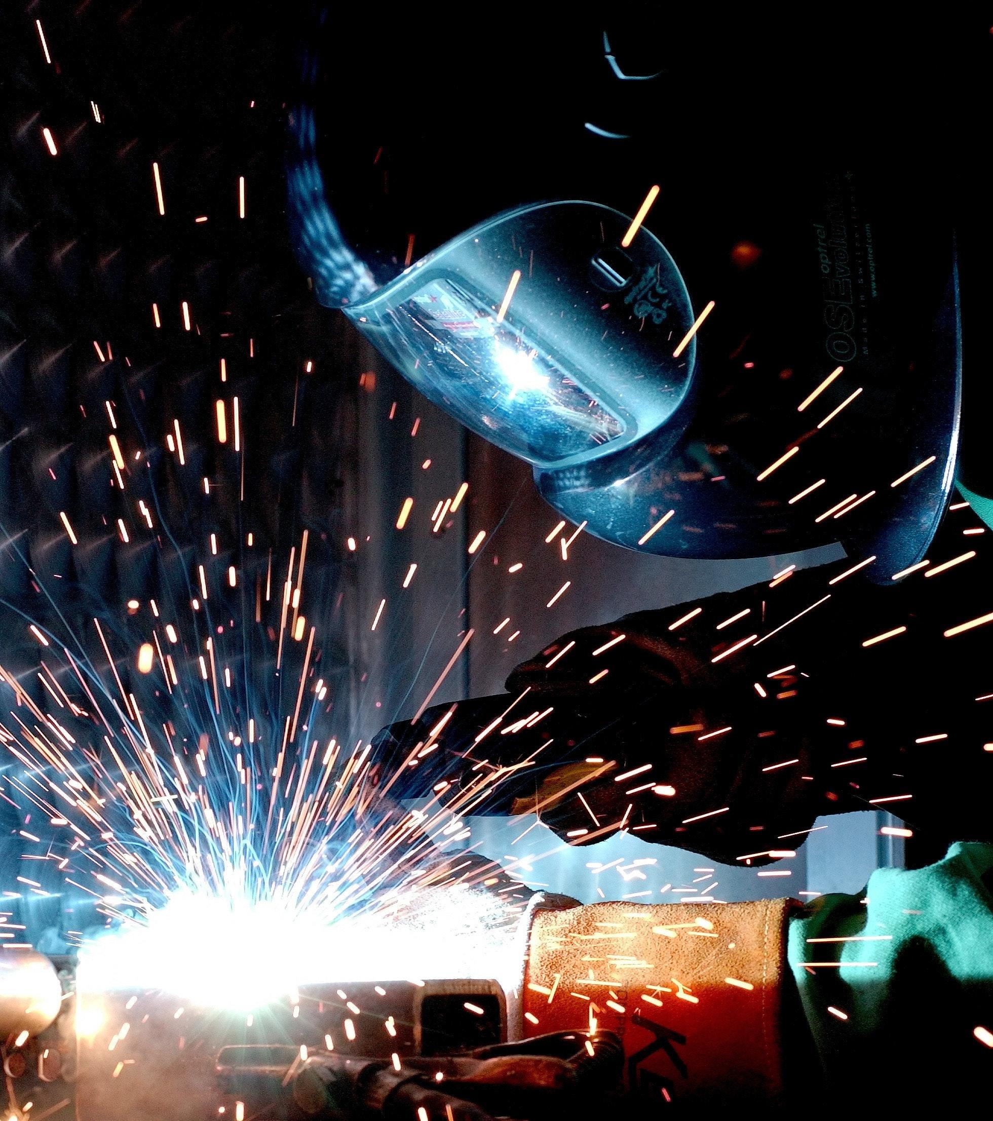 A worker wielding steel