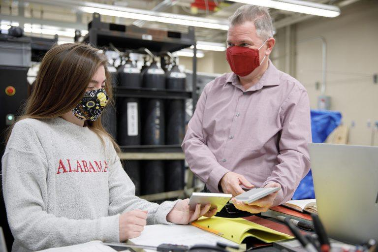 Twitter photo of a professor and student in masks working together in a lab