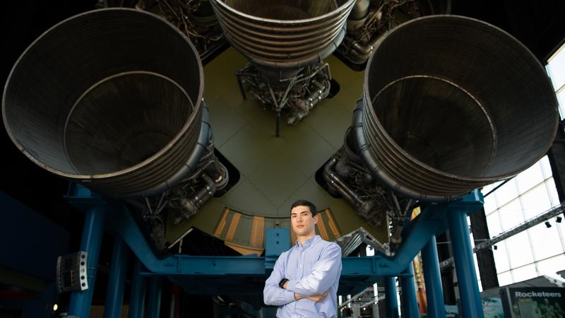 LinkedIn picture of a student with 3 huge rocket thrusters behind him