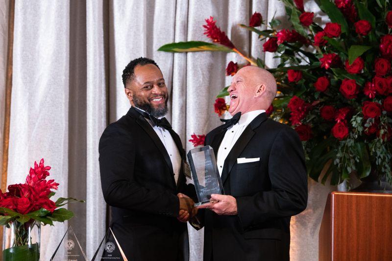 LinkedIn photo of Dr. Karr giving an award to J. Gaston Large III